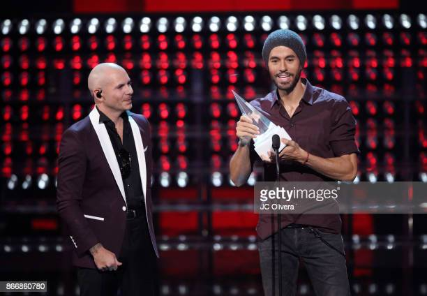 Recording artists Pitbull and Enrique Iglesias onstage during the 2017 Latin American Music Awards at Dolby Theatre on October 26 2017 in Hollywood...