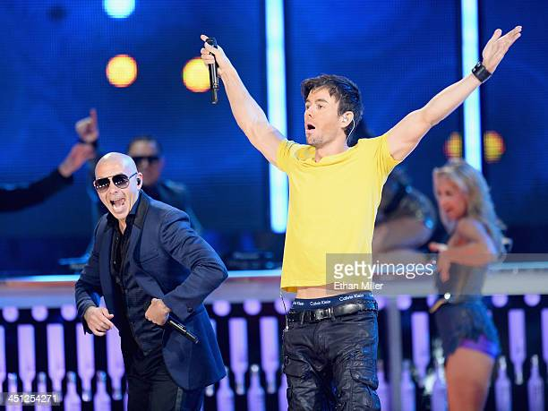 Recording artists Pitbull and Enrique Iglesias perform onstage during the 14th Annual Latin GRAMMY Awards held at the Mandalay Bay Events Center on...