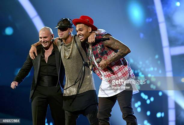 Recording artists Pitbull Wisin and Chris Brown perform onstage during the 15th annual Latin GRAMMY Awards at the MGM Grand Garden Arena on November...