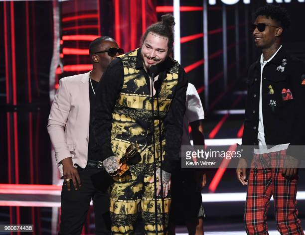 Recording artists Post Malone and 21 Savage accept the Top Rap Song award for 'Rockstar' onstage during the 2018 Billboard Music Awards at MGM Grand...