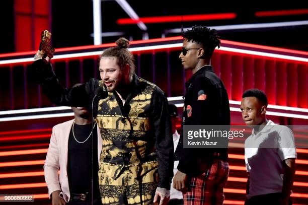 Recording artists Post Malone and 21 Savage accept Top Rap Song for 'Rockstar' onstage at the 2018 Billboard Music Awards at MGM Grand Garden Arena...