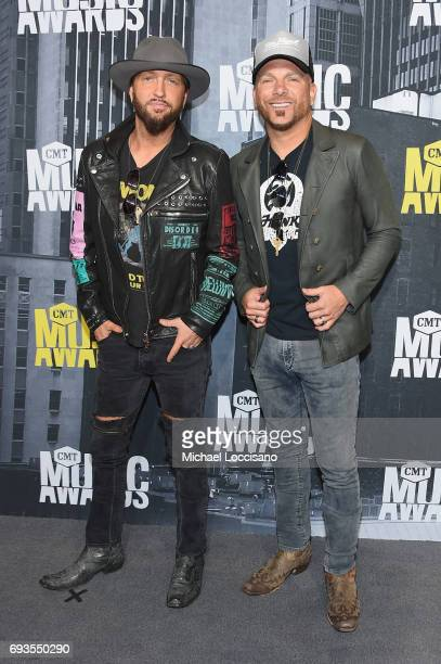 Recording artists Preston Brust and Chris Lucas of music group LoCash attend the 2017 CMT Music Awards at the Music City Center on June 7 2017 in...