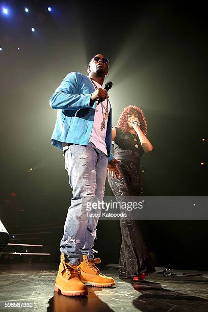 Recording artists Puff Daddy and Faith Evans perform on stage during the Live Nation presents Bad Boy Family Reunion Tour sponsored by Ciroc Vodka,...