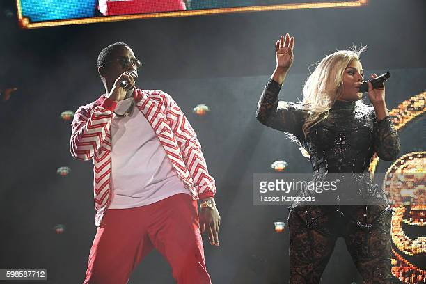 Recording artists Puff Daddy and Lil' Kim perform on stage during the Live Nation presents Bad Boy Family Reunion Tour sponsored by Ciroc Vodka,...