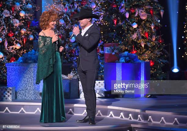 Recording artists Reba McEntire and Dustin Lynch perform during CMA 2017 Country Christmas at The Grand Ole Opry on November 14 2017 in Nashville...