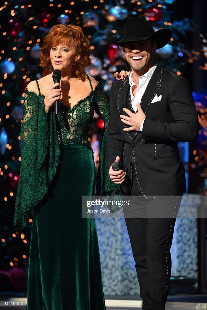 Recording Artists Reba McEntire and Dustin Lynch speak on stage during 2017 CMA Country Christmas at The Grand Ole Opry on November 14, 2017 in Nashville, Tennessee.