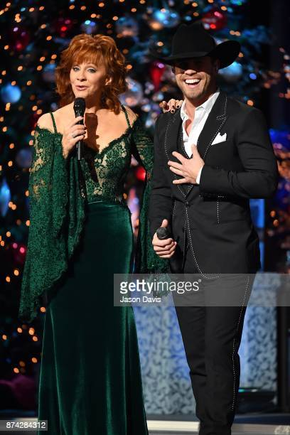 Recording Artists Reba McEntire and Dustin Lynch speak on stage during 2017 CMA Country Christmas at The Grand Ole Opry on November 14 2017 in...