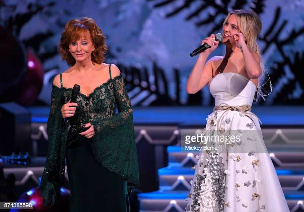 Recording artists Reba McEntire and Kelsea Ballerini perform during CMA 2017 Country Christmas at The Grand Ole Opry on November 14 2017 in Nashville...