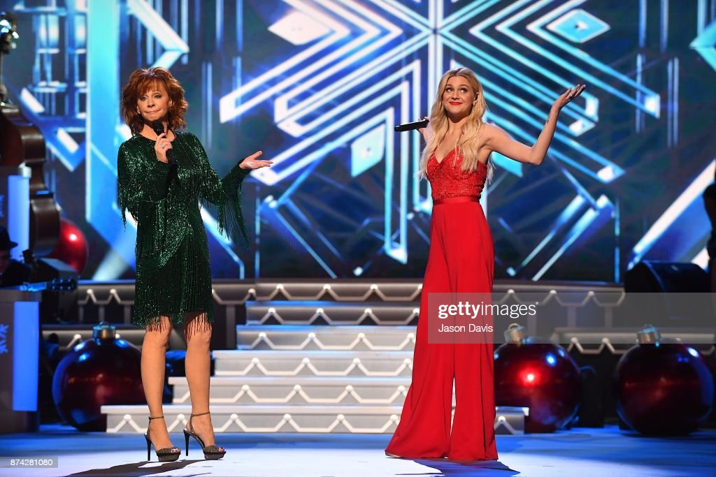Recording Artists Reba McEntire and Kelsea Ballerini perform on stage during 2017 CMA Country Christmas at The Grand Ole Opry on November 14, 2017 in Nashville, Tennessee.