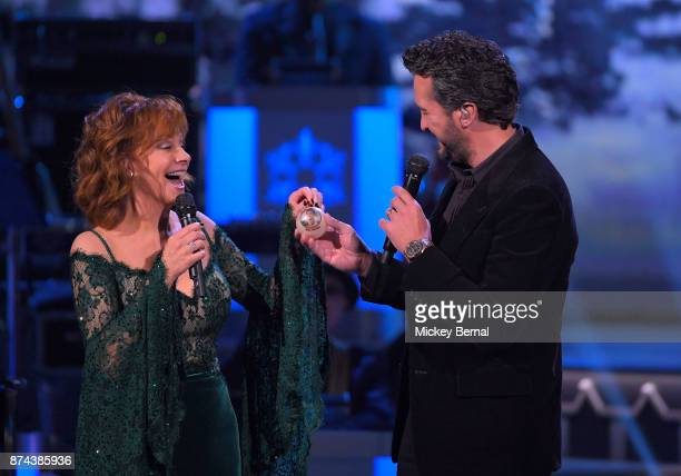 Recording artists Reba McEntire and Luke Bryan perform during CMA 2017 Country Christmas at The Grand Ole Opry on November 14 2017 in Nashville...