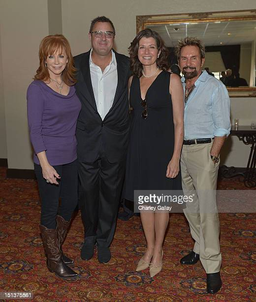Recording artists Reba McEntire Vince Gill and Amy Grant and producer Tony Brown attend a luncheon following Vince Gill being honored with a Star on...