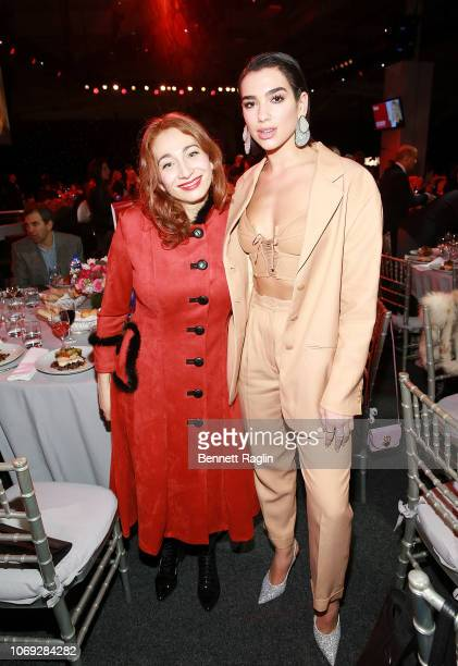 Recording artists Regina Spektor and Dua Lipa attend the Billboard's Women In Music 2018 with FIJI water at Pier 36 on December 6 2018 in New York...