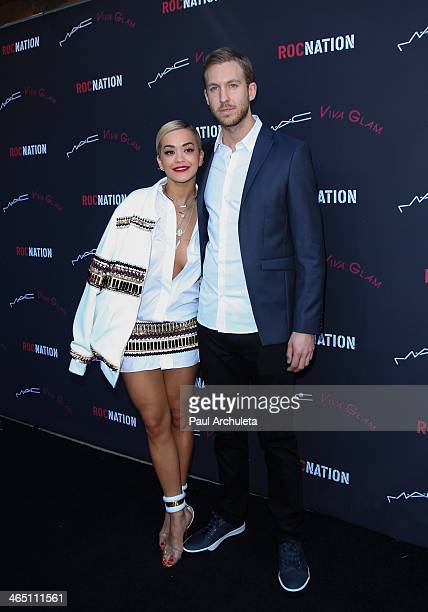 Recording Artists Rita Ora and Calvin Harris attend the Roc Nation preGrammy brunch on January 25 2014 in Los Angeles California