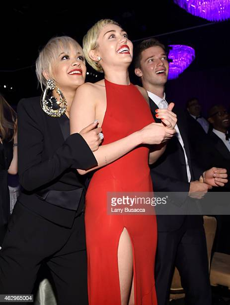Recording artists Rita Ora Miley Cyrus and model Patrick Schwarzenegger attend the PreGRAMMY Gala and Salute To Industry Icons honoring Martin...