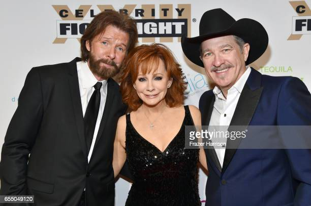 Recording artists Ronnie Dunn Reba McEntire and Kix Brooks attend Muhammad Ali's Celebrity Fight Night XXIII at the JW Marriott Desert Ridge Resort...