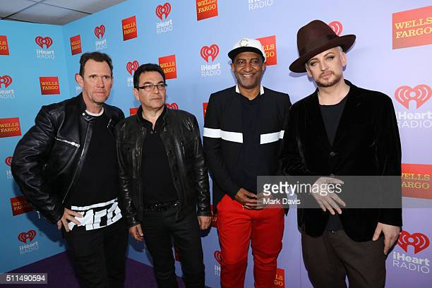 Recording artists Roy Hay Jon Moss Mikey Craig and Boy George of music group Culture Club pose backstage during the first ever iHeart80s Party at The...