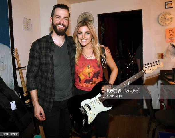 Recording artists Ryan Kinder and Lindsay Ell pose backstage during the ACM After Party For A Cause I Love This Bar Grill at Toby Keith's I Love This...