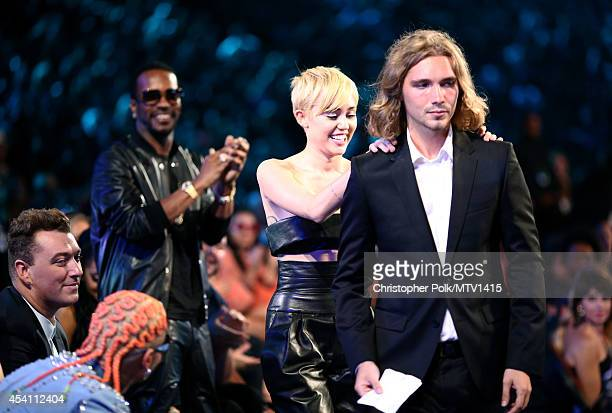 Recording artists Sam Smith Juicy J Miley Cyrus and My Friend's Place representative Jesse Helt attend the 2014 MTV Video Music Awards at The Forum...