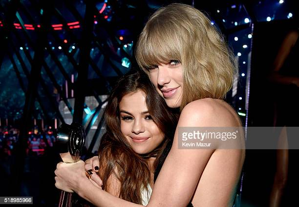 Recording artists Selena Gomez and Taylor Swift backstage at the iHeartRadio Music Awards which broadcasted live on TBS TNT AND TRUTV from The Forum...
