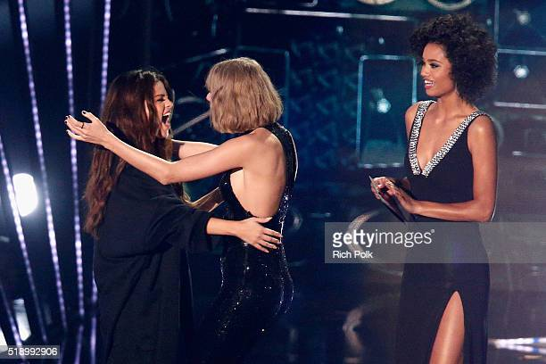 Recording artists Selena Gomez and Taylor Swift hug onstage during the iHeartRadio Music Awards at The Forum on April 3 2016 in Inglewood California