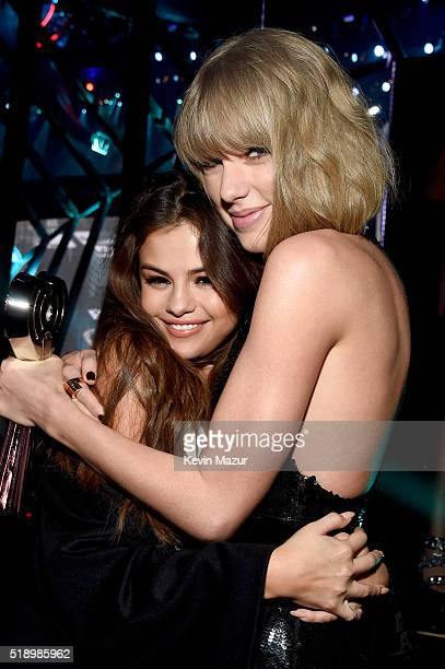 Recording artists Selena Gomez winner of the 'Biggest Triple Threat' award and Taylor Swift winner of the 'Best Tour' award backstage at the...