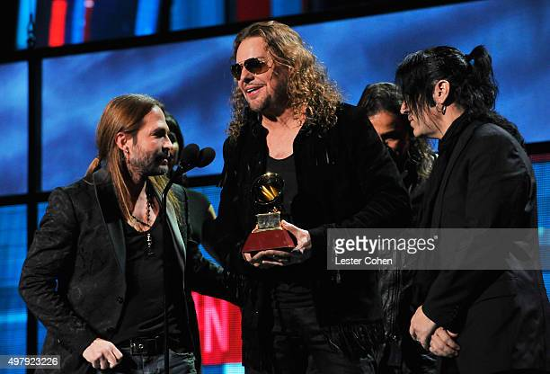 Recording artists Sergio Vallin Fher Olvera and Alex Gonzalez of music group Mana accept the Best Pop/Rock Album award for 'Cama Incendiada' onstage...