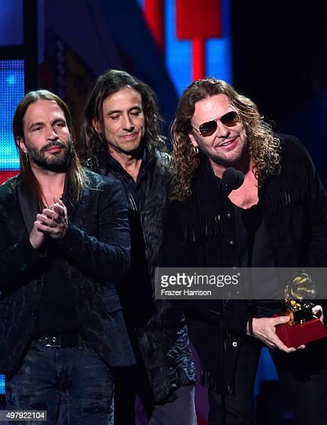 Recording artists Sergio Vallin Juan Calleros and Fher Olvera of music group Mana accept the Best Pop/Rock Album award for Cama Incendiada onstage...