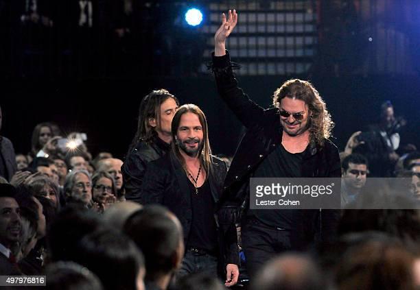 Recording artists Sergio Vallin Juan Calleros and Fher Olvera of music group Mana accept the Best Pop/Rock Album award for 'Cama Incendiada' during...