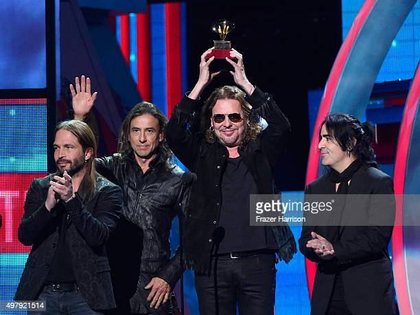 Recording artists Sergio Vallin Juan Calleros Fher Olvera and Alex Gonzalez of music group Mana accept the Best Pop/Rock Album award for 'Cama...