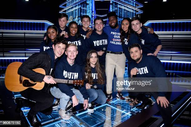 Recording artists Shawn Mendes and Khalid pose with youth performers onstage at the 2018 Billboard Music Awards at MGM Grand Garden Arena on May 20...