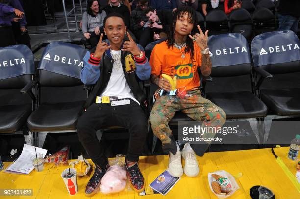 Recording artists Slim Jxmmi and Swae Lee of the hiphop group Rae Sremmurd attend a basketball game between the Los Angeles Lakers and the Atlanta...