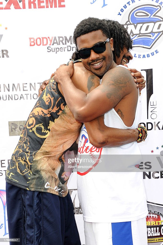 Recording artists Snoop Dogg (L) and Ray J attend the 1st Annual Athletes VS Cancer Celebrity Flag Football Game on August 18, 2013 in Pacific Palisades, California.