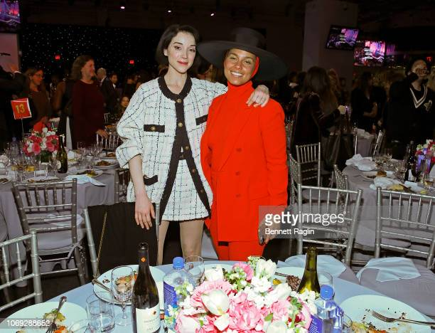 Recording artists St Vincent and Alicia Keys attend the Billboard's Women In Music 2018 with FIJI water at Pier 36 on December 6 2018 in New York City