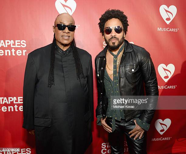 Recording artists Stevie Wonder and Lenny Kravitz attend the 2016 MusiCares Person of the Year honoring Lionel Richie at the Los Angeles Convention...
