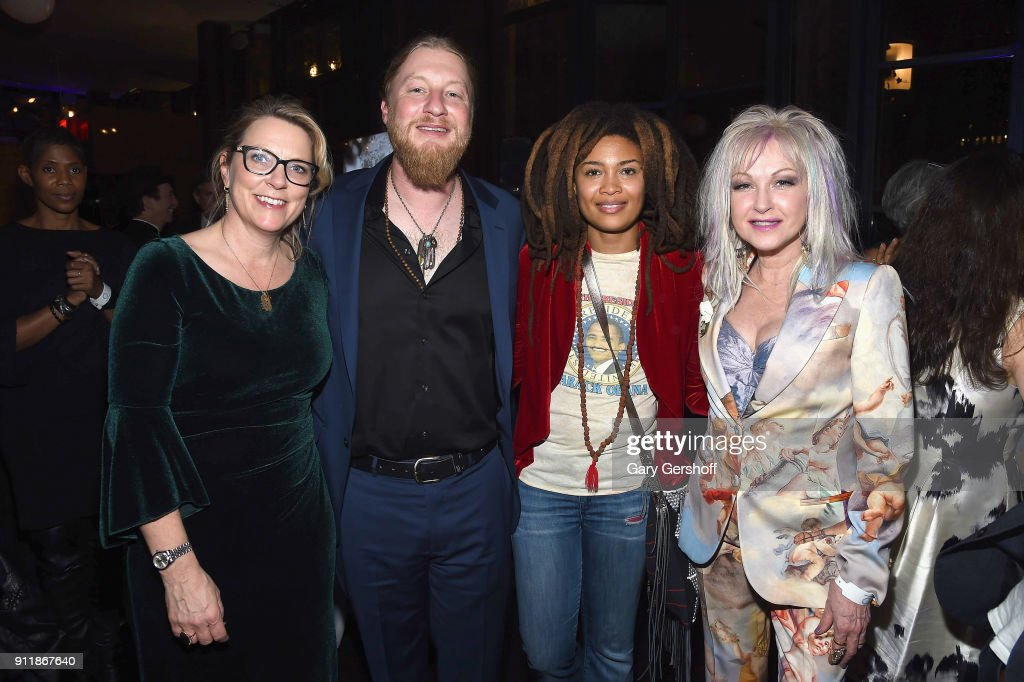 Recording artists Susan Tedeschi, Derek Trucks, Valerie June and Cyndi Lauper attend the Concord Music Group Grammy party at Bryant Park Grill on January 28, 2018 in New York City.