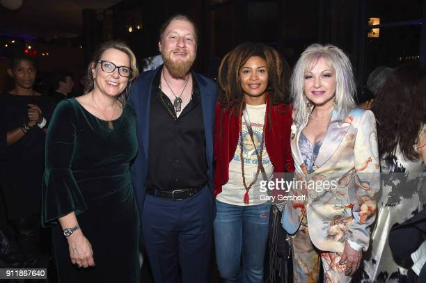 Recording artists Susan Tedeschi, Derek Trucks, Valerie June and Cyndi Lauper attend the Concord Music Group Grammy party at Bryant Park Grill on...