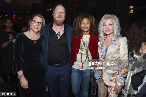Recording artists Susan Tedeschi Derek Trucks Valerie June and Cyndi Lauper attend the Concord Music Group Grammy party at Bryant Park Grill on...