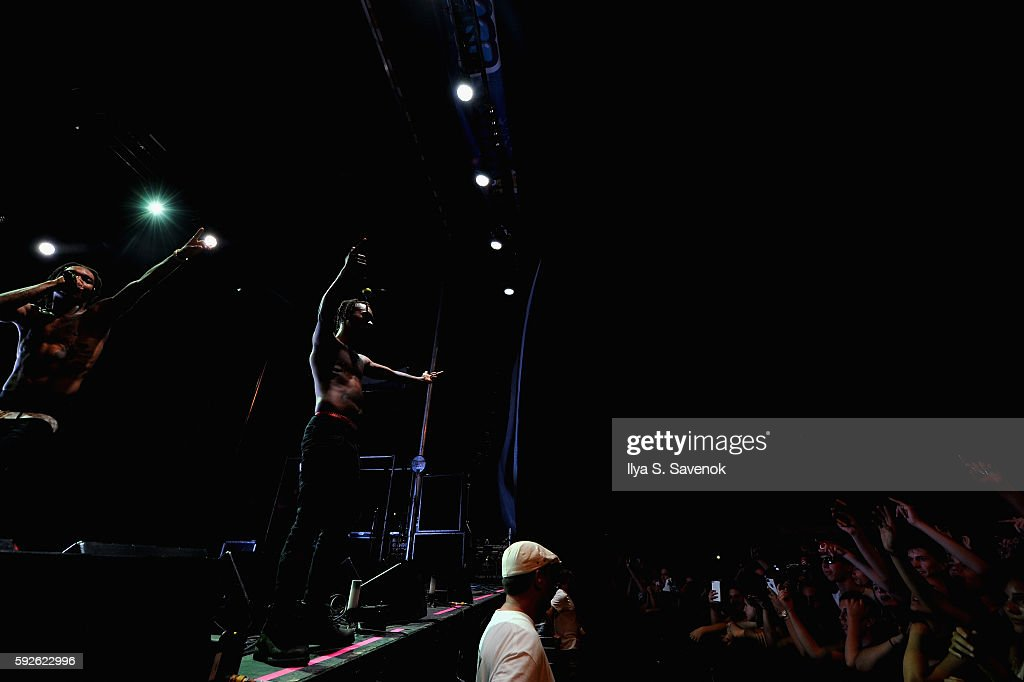 Recording artists Swae Lee (L) and Slim Jimmy of Rae Sremmurd perform onstage during the 2016 Billboard Hot 100 Festival - Day 1 at Nikon at Jones Beach Theater on August 20, 2016 in Wantagh, New York.