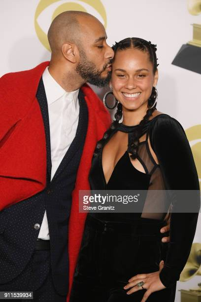 Recording artists Swizz Beatz and Alicia Keys winners of the The Recording Academy's Producers and Engineers Wing poses in the press room during the...