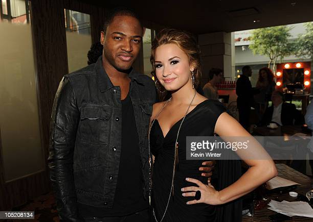 Recording artists Taio Cruz and Demi Lovato attend the 2010 American Music Awards Nominations Press Conference held at The Mixing Room at the JW...