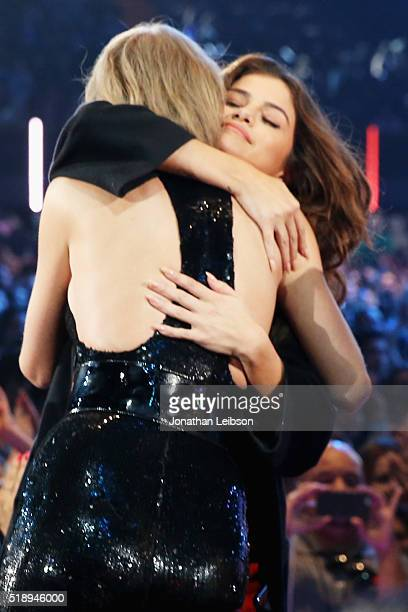 Recording artists Taylor Swift and Selena Gomez hug during the iHeartRadio Music Awards at The Forum on April 3 2016 in Inglewood California