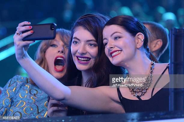 Recording artists Taylor Swift Lorde and guest take a selfie at the 2014 MTV Video Music Awards at The Forum on August 24 2014 in Inglewood California