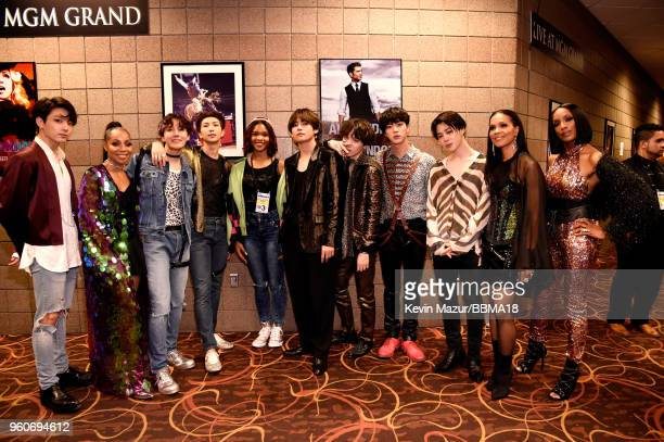 Recording artists Terry Ellis Cindy Herron and Rhona Bennett of musical group En Vogue pose with members of musical group BTS at the 2018 Billboard...