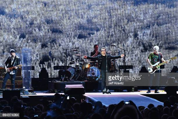 Recording artists The Edge Larry Mullen Jr Bono and Adam Clayton of U2 perform onstage at What Stage during Day 2 of the 2017 Bonnaroo Arts And Music...