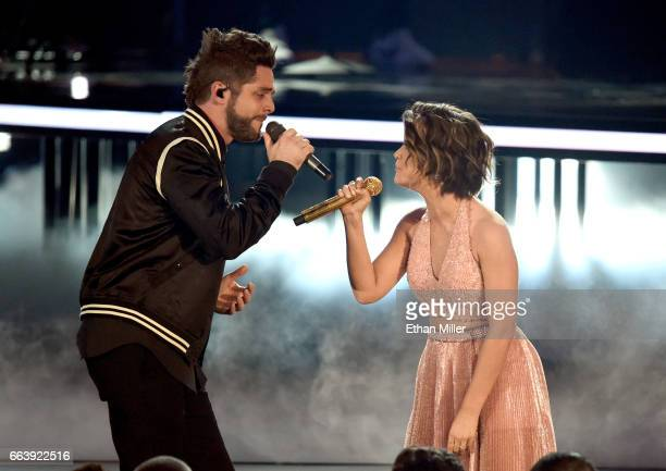 Recording artists Thomas Rhett and Maren Morris perform onstage during the 52nd Academy of Country Music Awards at TMobile Arena on April 2 2017 in...