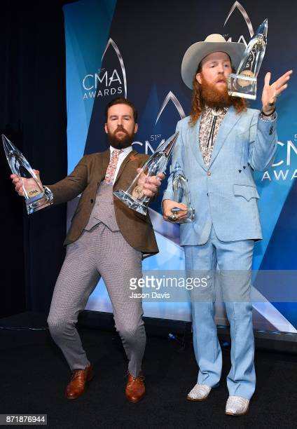 Recording Artists TJ Osborne and John Osborne of Brothers Osborne celebrate winning Vocal Duo of the year during 51st annual CMA Awards at the...