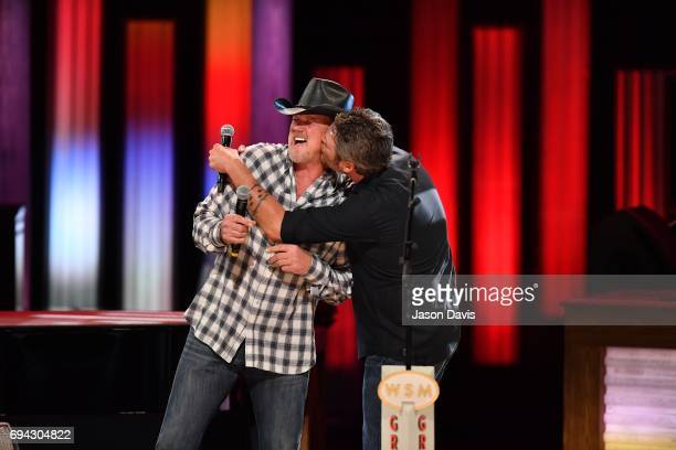 Recording Artists Trace Adkins and Blake Shelton perform onstage at The Grand Ole Opry on June 8 2017 in Nashville Tennessee