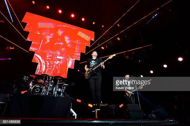 Recording artists Travis Barker Mark Hoppus and Matt Skiba of music group Blink182 perform onstage at KROQ Weenie Roast 2016 at Irvine Meadows...