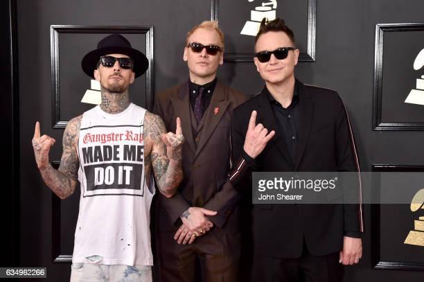 Recording artists Travis Barker Matt Skiba and Mark Hoppus of music group blink182 attend The 59th GRAMMY Awards at STAPLES Center on February 12...