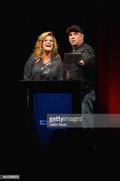 Recording artists Trisha Yearwood and Garth Brooks present awards during the Opening Ceremonies of CRS 2015 on February 25 2015 at the Nashville...
